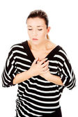 Woman having chest pain — Stock Photo