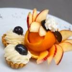 Petit four with fruit design — Stock Photo #7795480