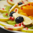 Fresh juicy fruit salad on a plate. — ストック写真
