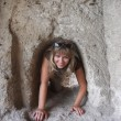 Crawling in rock tunnel — Stock Photo