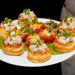 Royalty-Free Stock Photo: Tartlets with salad on dish