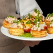Tartlets with salad on dish — Stock Photo