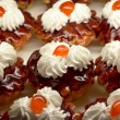 Small cupcakes with cream and cherry #2 — Zdjęcie stockowe