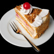 Fancy tart with cherry on top — Stock Photo