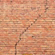 Cracked redbrick wall - Stock Photo