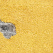 Yellow punched stucco — Stock Photo