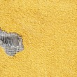 Yellow punched stucco — Stock Photo #7795846