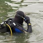 Scuba diver entering the water — Stock Photo #7795896