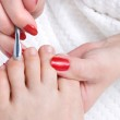 Постер, плакат: Pedicure applying