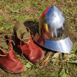 Teutonic medieval boots and helmet — Stock Photo