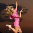 Girl outdoor jumping — Stock Photo