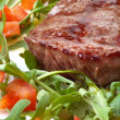 Beef steak with rocket salad - Stock Photo