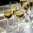 Glasses of white wine - Stock Photo