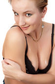 Young sexy blond woman in black bra. — Stock Photo
