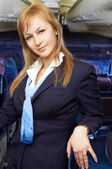 Blond air hostess (stewardess) — Stock Photo