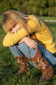 Blond girl squatting — Stock Photo