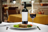 Meat and wine served — Stock Photo