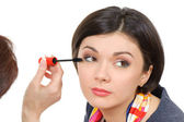 Applying mascara using lash brush — Stock Photo