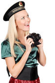 Blond marine girl with camera — Stock Photo