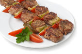Grilled kebab with vegetables — Stock Photo