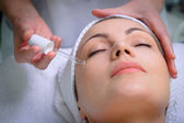 Pretty woman getting special skin treatment at beauty salon — Stock Photo