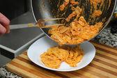 Pouring pasta — Stock Photo