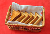 Toasted bread in the wicker basket — Stock Photo