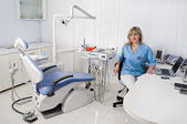Dentist in her office — Stock Photo