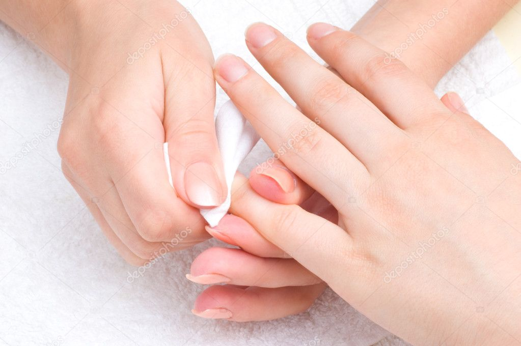 Manicure applying - wiping the mosturizer from end of fingers — Stock Photo #7796371
