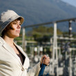 Woman switching on the energy station - Stock Photo