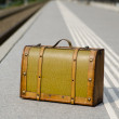 Royalty-Free Stock Photo: Old suitcase on a train station