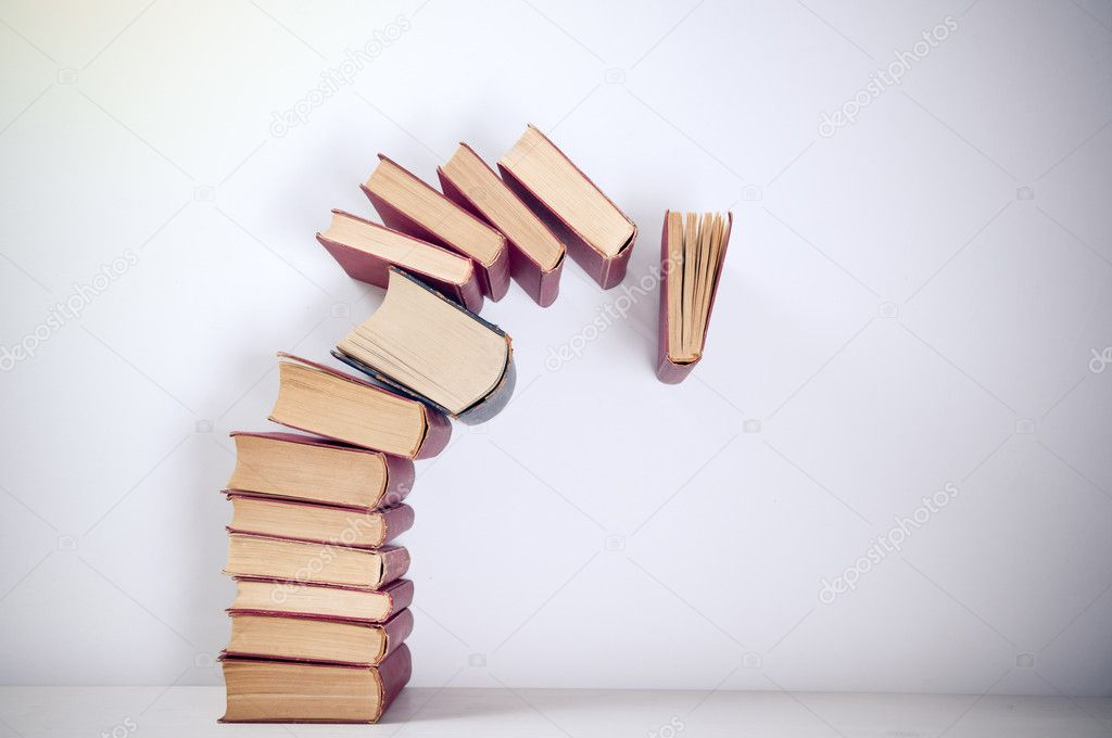 Falling books on simple background — Stock Photo #7869476