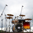 Drums on a stage in a park - Stock Photo