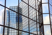Reflections in glass facade — Stock Photo