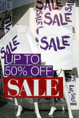 The word Sale on paper bags in shopping window — Stock Photo