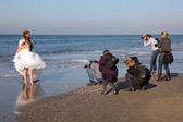 Photographing a wedding on a beach — Stock Photo
