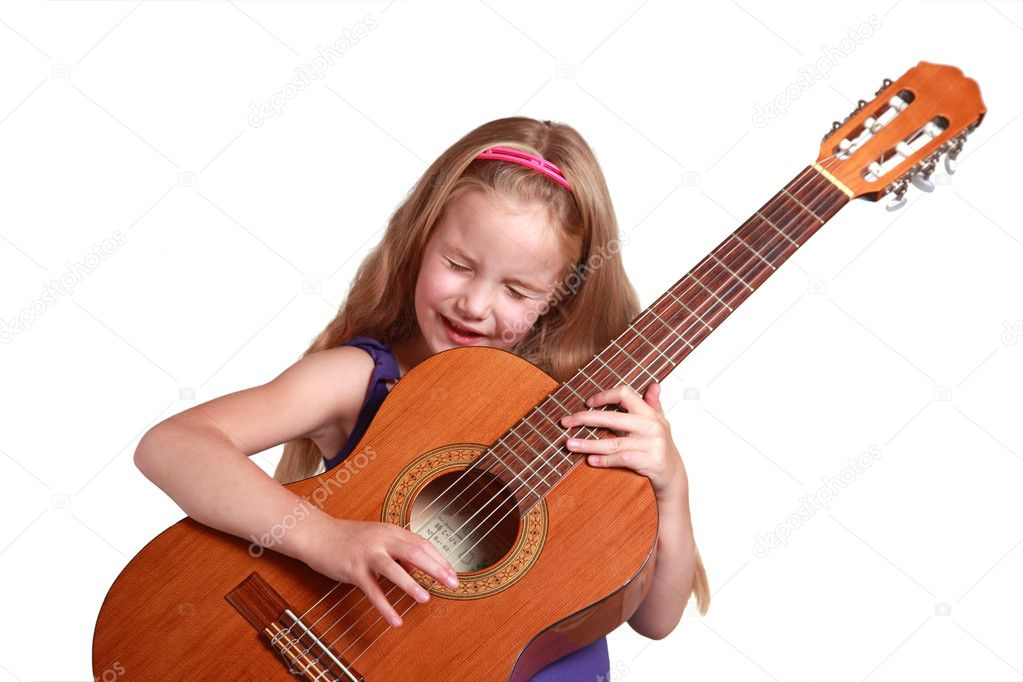 Little girl in purple dress with spanish guitar and white background — Stock Photo #7888951