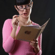 Thinking student girl with exersise book — Stock Photo