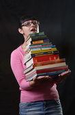 Fille d'étudiant avec des tas de livres — Photo