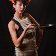Foto Stock: Housewife with frying pan
