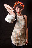 Housewife with a kettle — Stock Photo