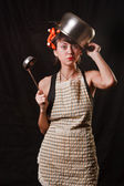 Housewife with a pan on her head — Stock Photo
