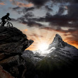 Silhouette biker in the Swiss Alps — Stock Photo #7865143