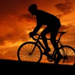 Cyclist riding a road bike at sunset — Stock Photo #7865474