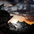 Silhouette biker in the Swiss Alps — Stock Photo #7865868
