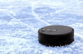 Black hockey puck — Stock Photo