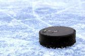 Black hockey puck — Stock Photo