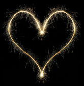 Heart from Christmas sparkler — Stock Photo