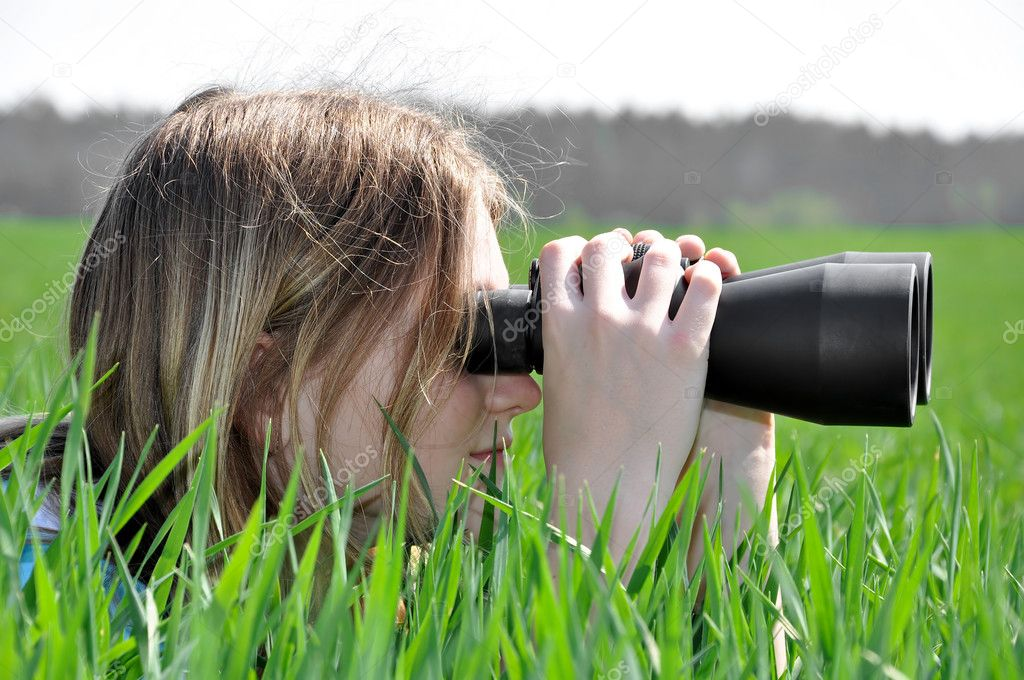 Girl looking through binoculars — Stock Photo #7865557