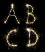 Christmas alphabet created a sparkler — Stock Photo